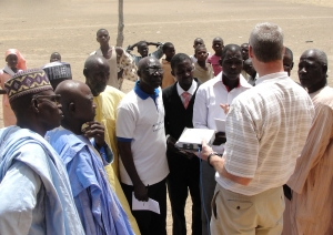 Bruce Smith visits with Nigerian nationals showing BTAK
