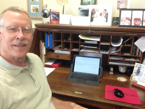 Bruce at his desk at Wycliffe Associates
